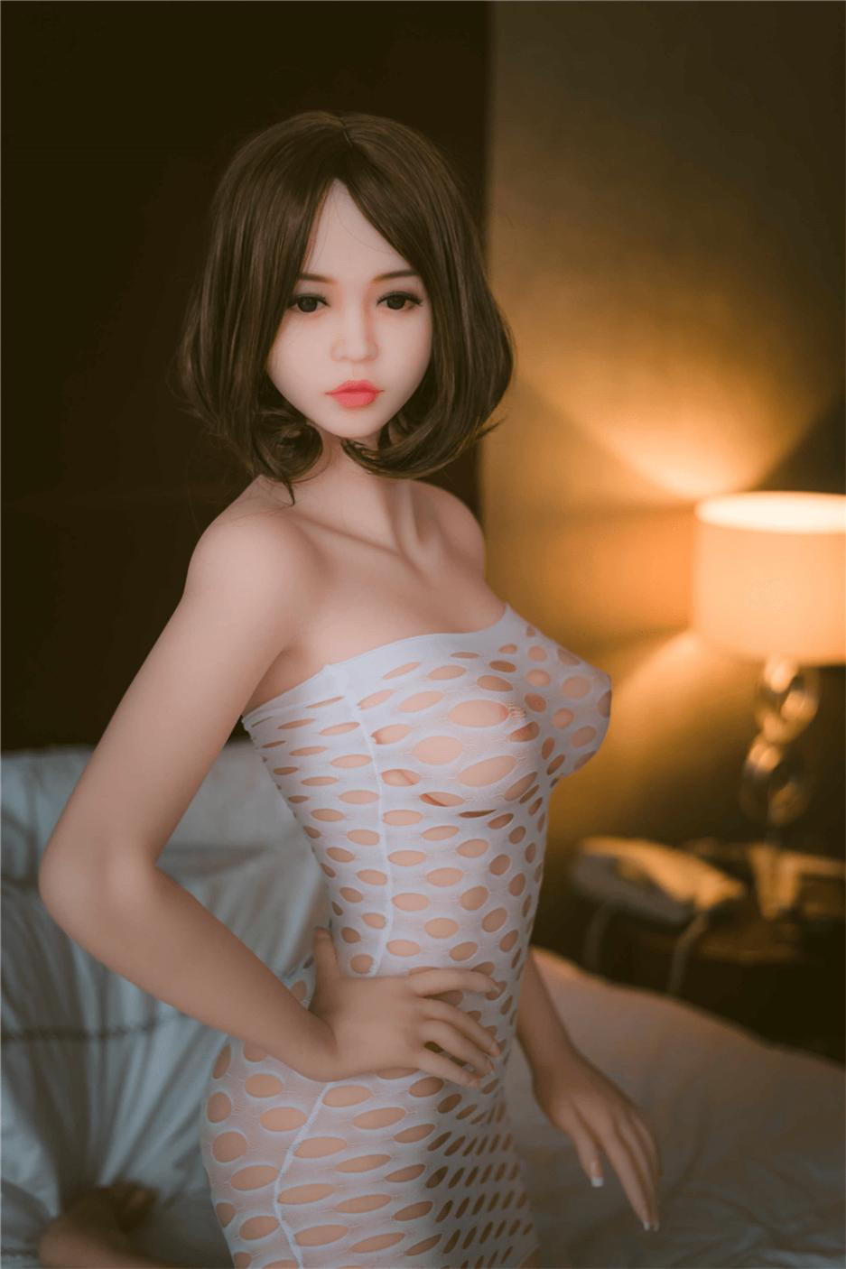 Cute Sex Doll With A Fork On The Waist