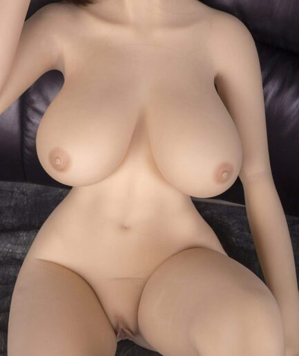 Sex doll lying naked on the sofa