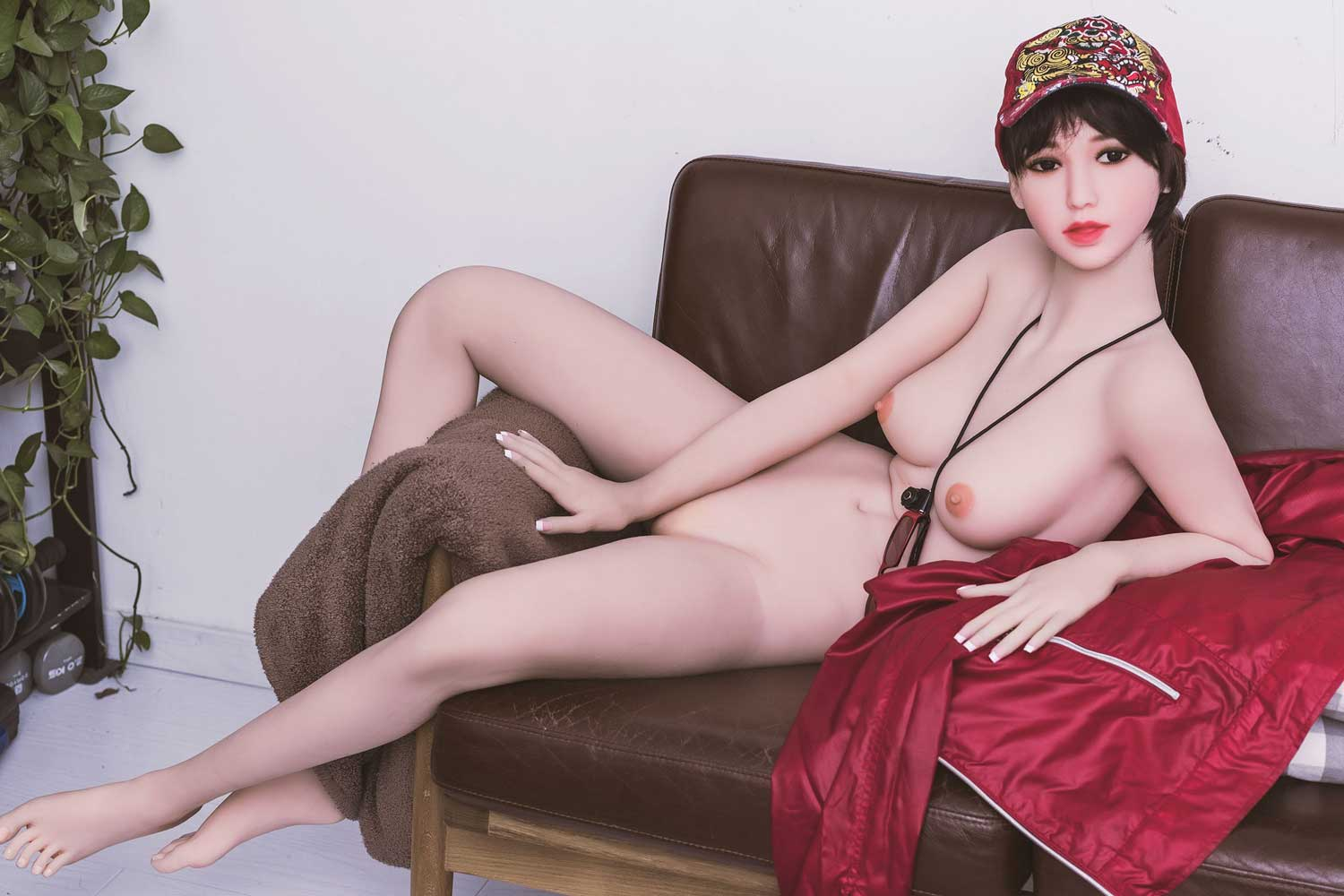 Sex doll sitting naked on the sofa