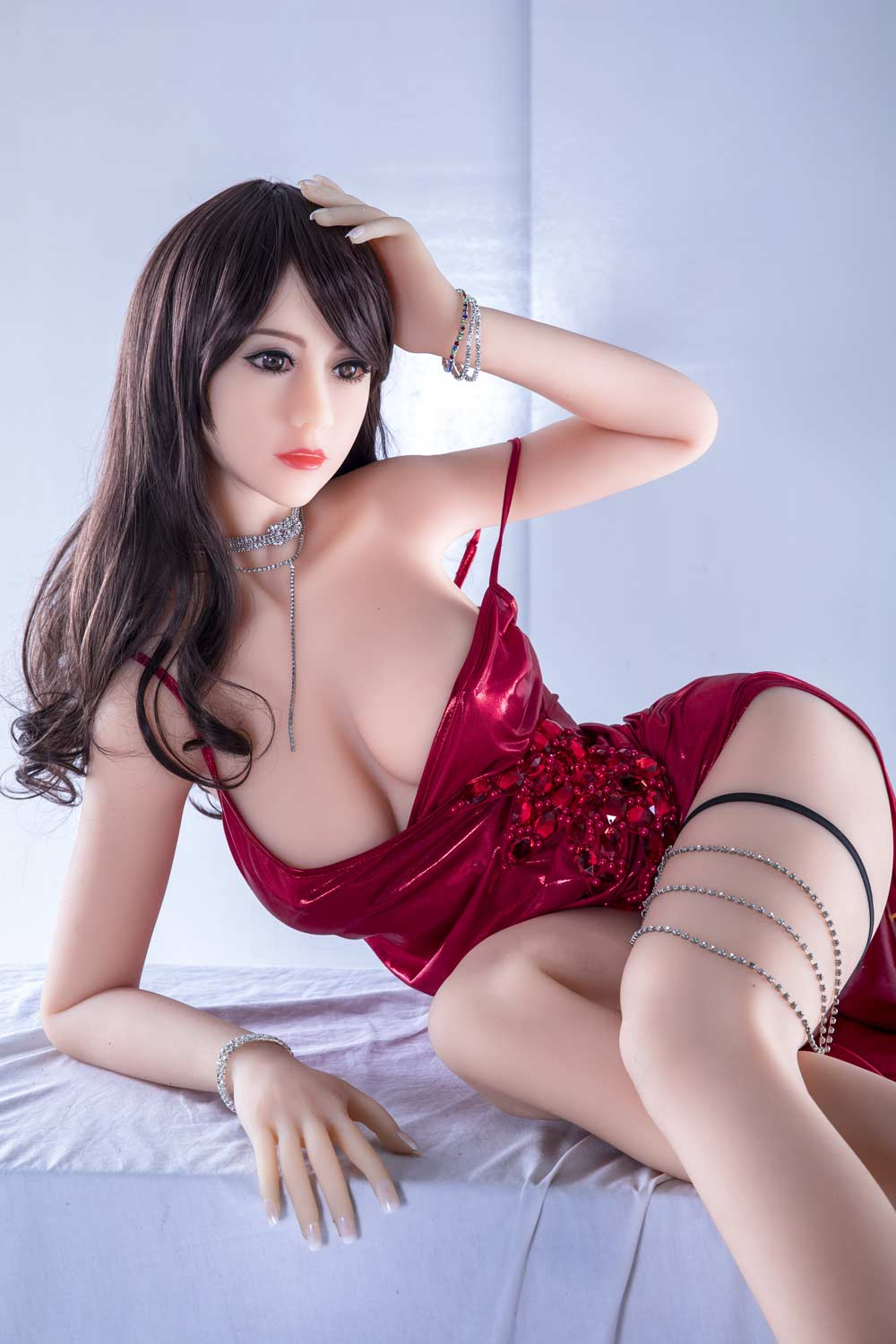 Sex doll sitting on the table and touching hair