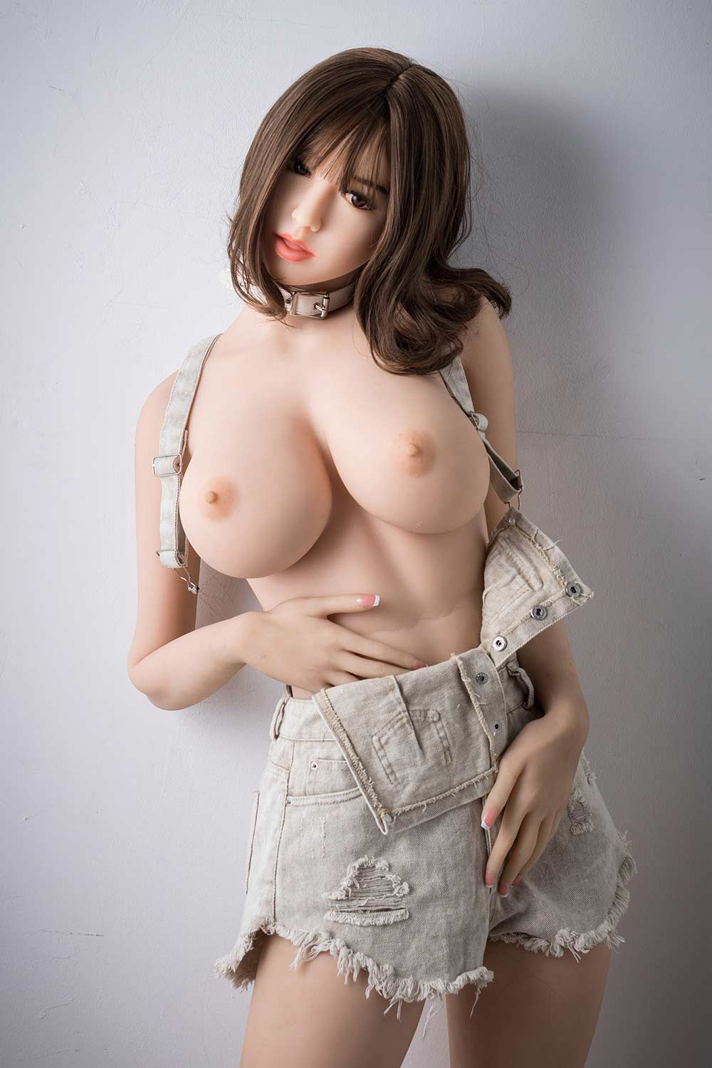 Sex doll with hands in pants