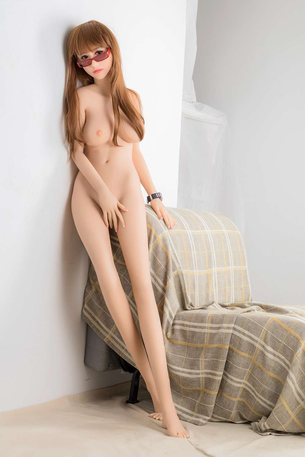Sex doll with hands on sofa armrests