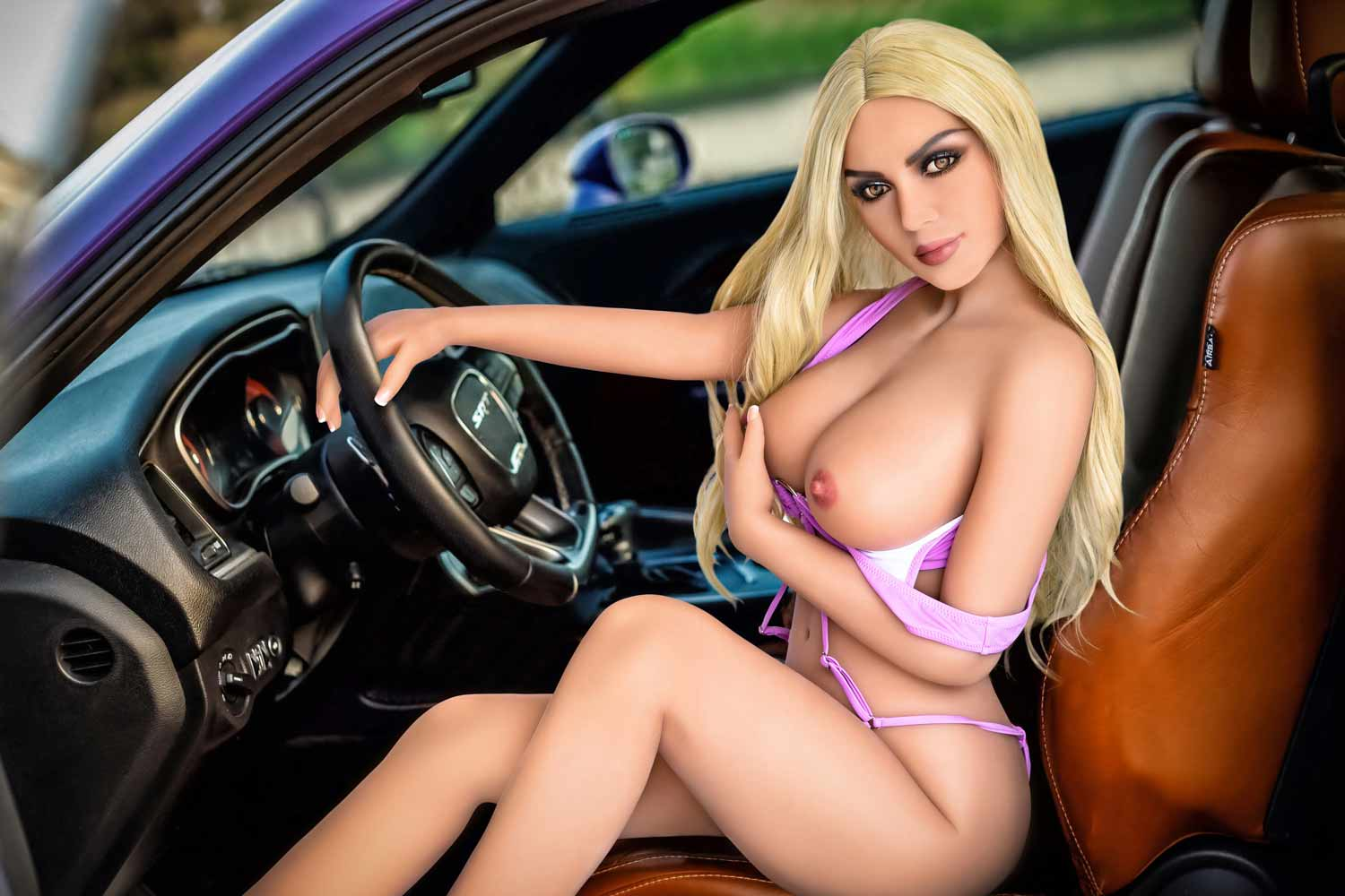 Sex doll with hands on steering wheel