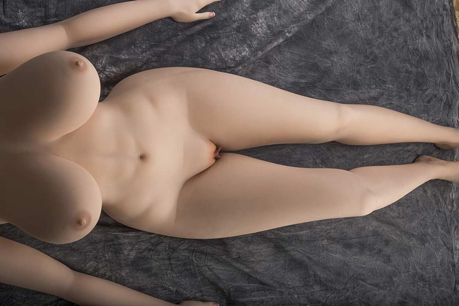 Sex doll with hands on the bed