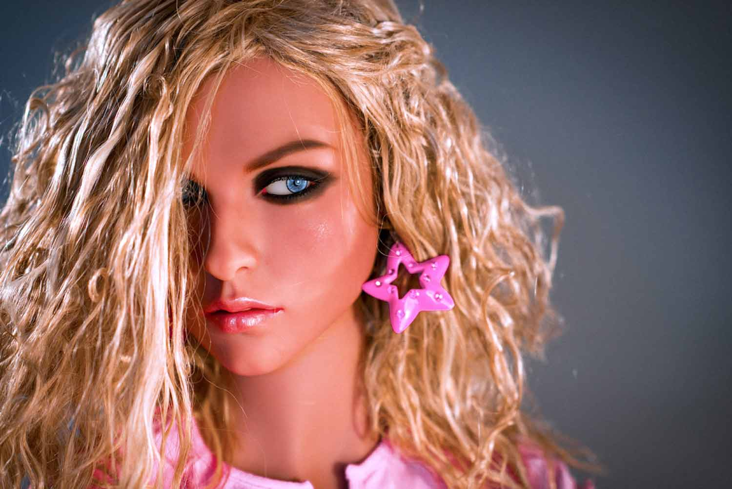 Sex doll with pink star earrings