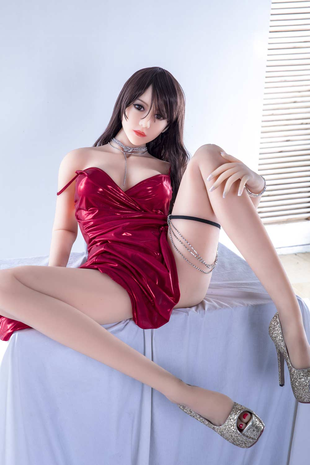 Sex doll with spread legs and hands touching thighs