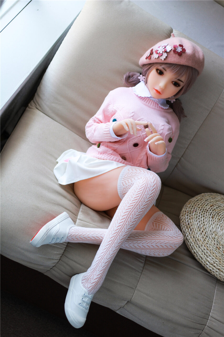 Sexy Doll Sitting On The Sofa