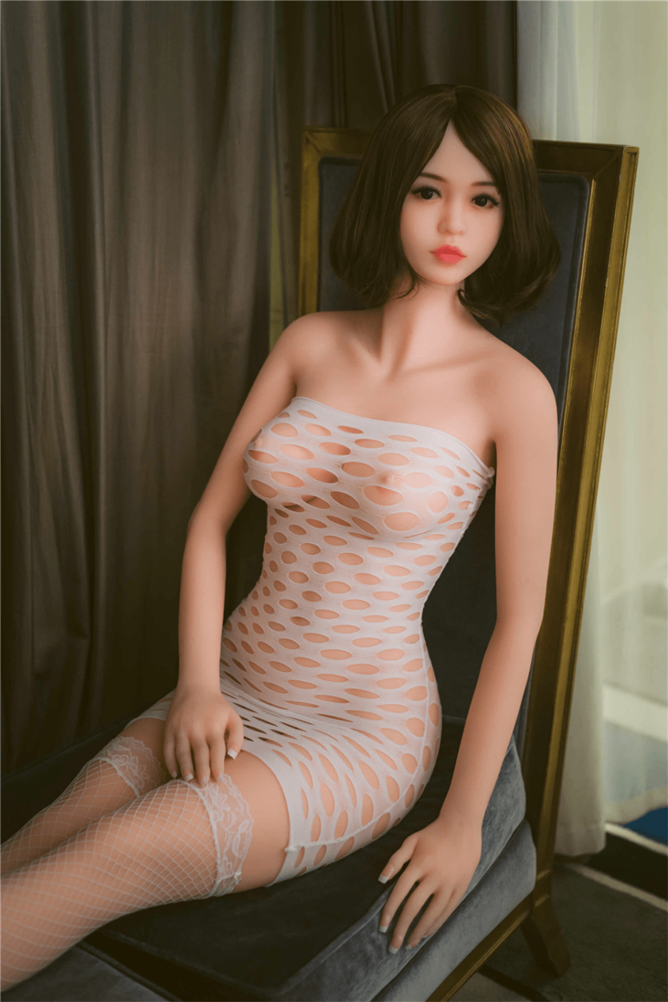 Sexy Sex Doll Sitting In A Chair