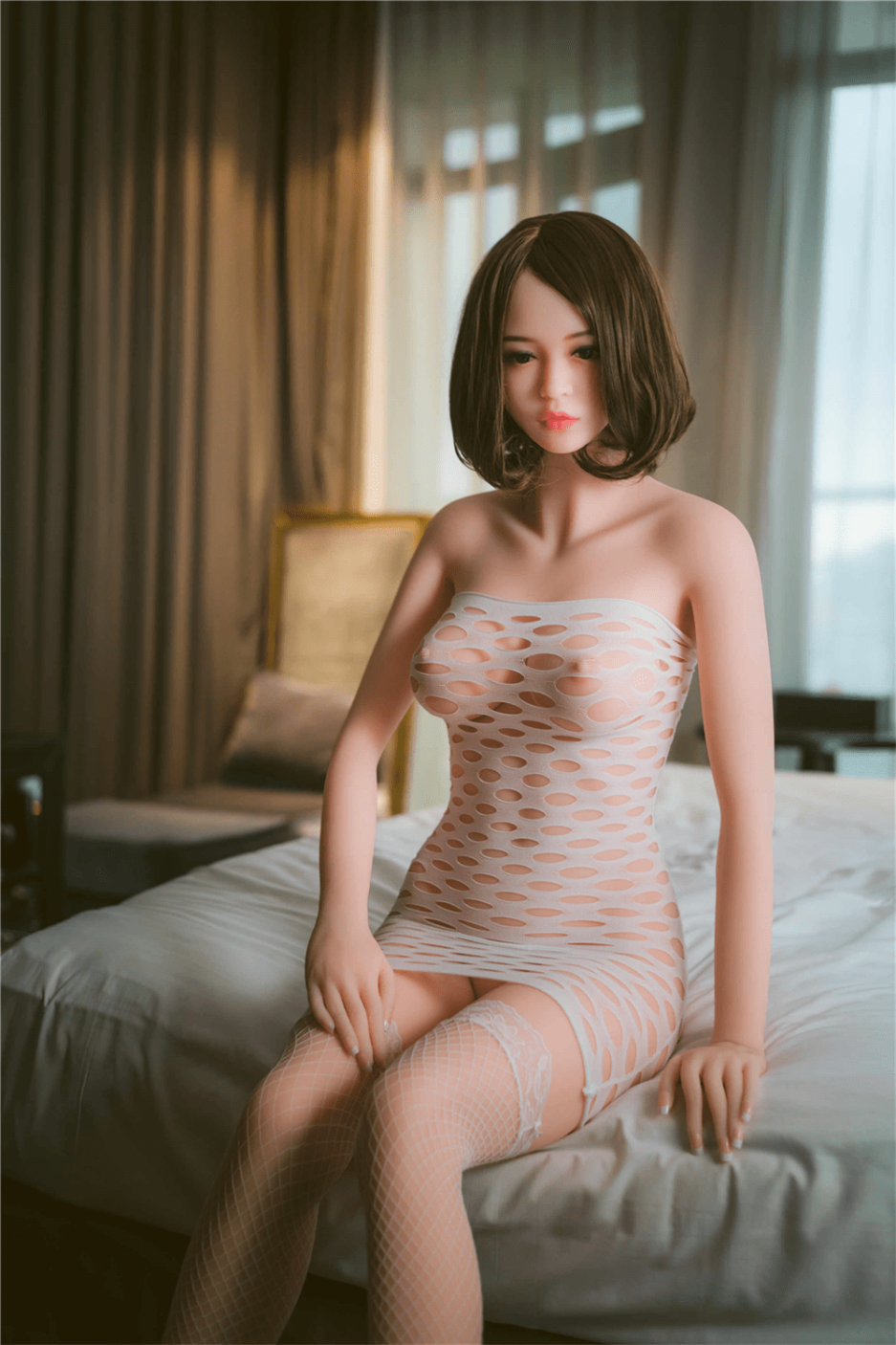 Sex Doll Sitting On The Bed