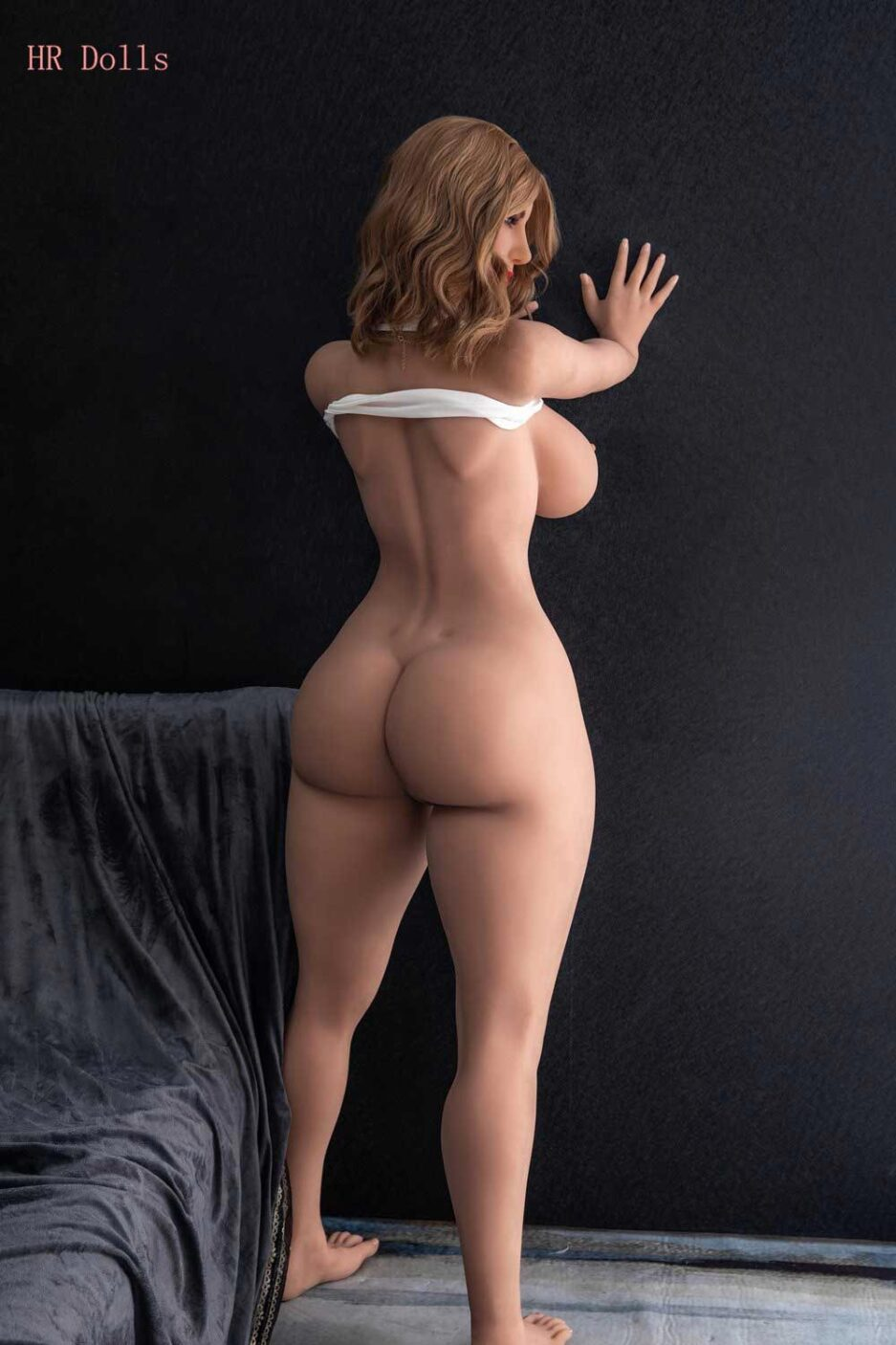 Big ass sex doll with hands on the wall