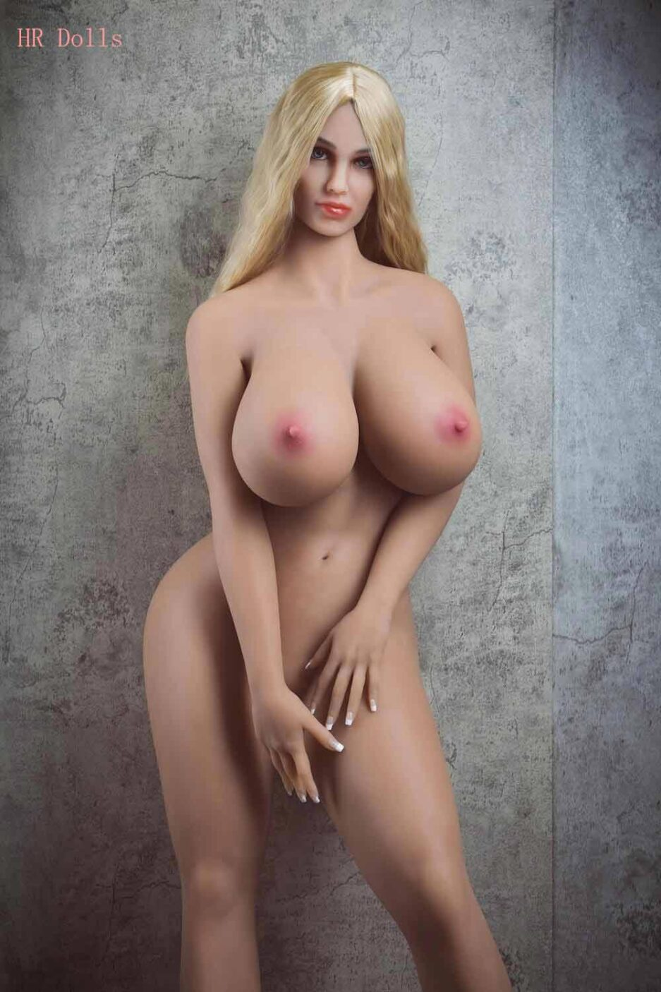 Big breasted sex doll with hands covering the lower body