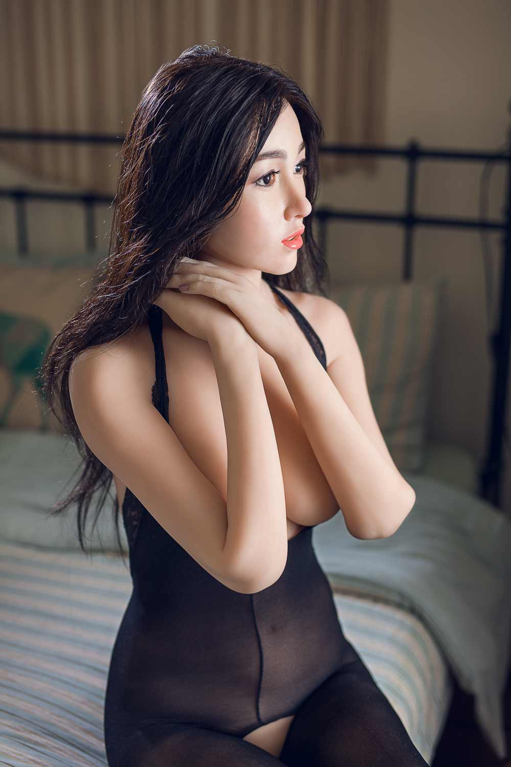 Black-haired silicone sex doll