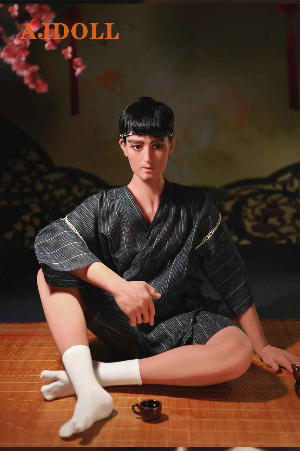 Male sex doll sitting on the mat