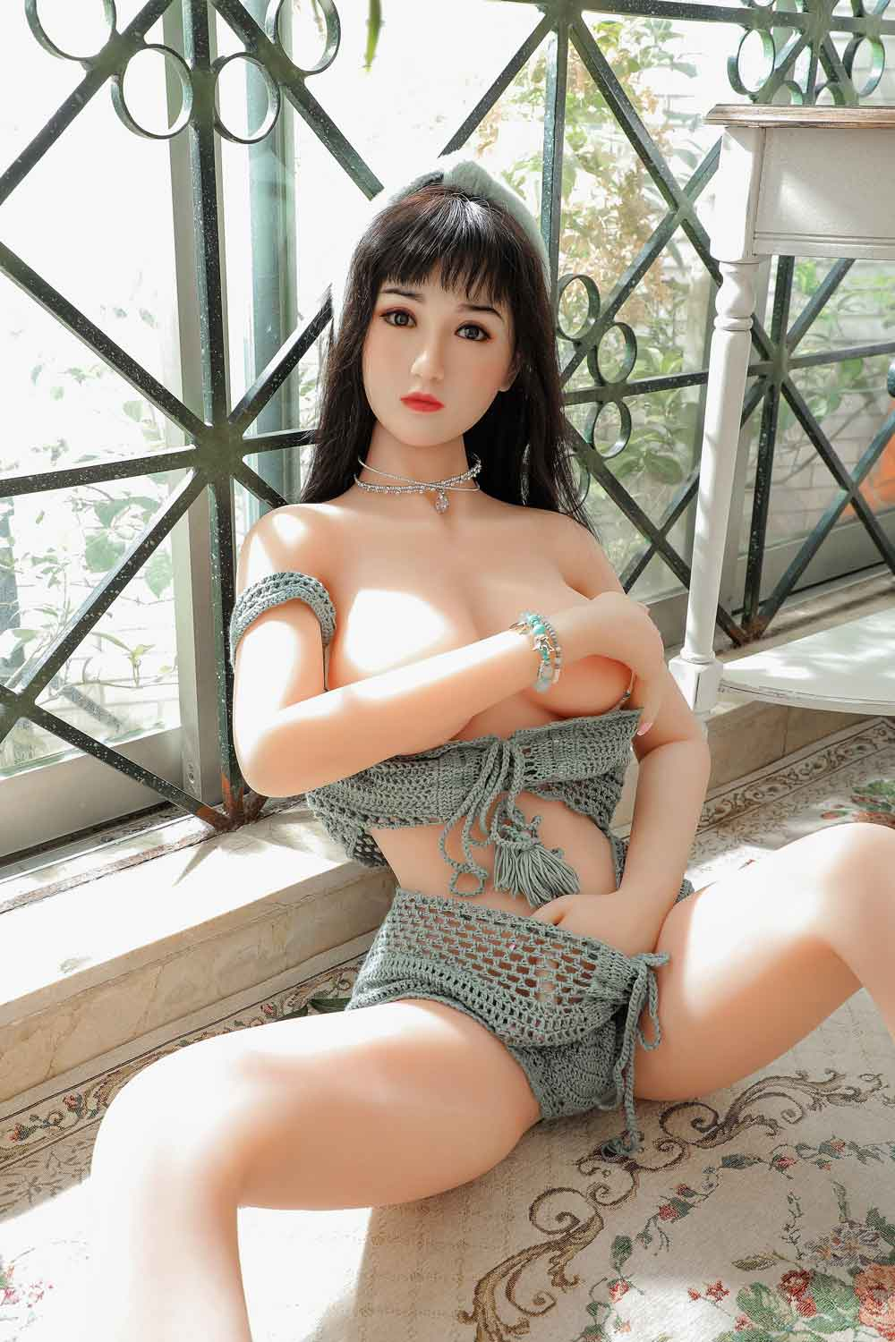 Sex doll with one hand on chest
