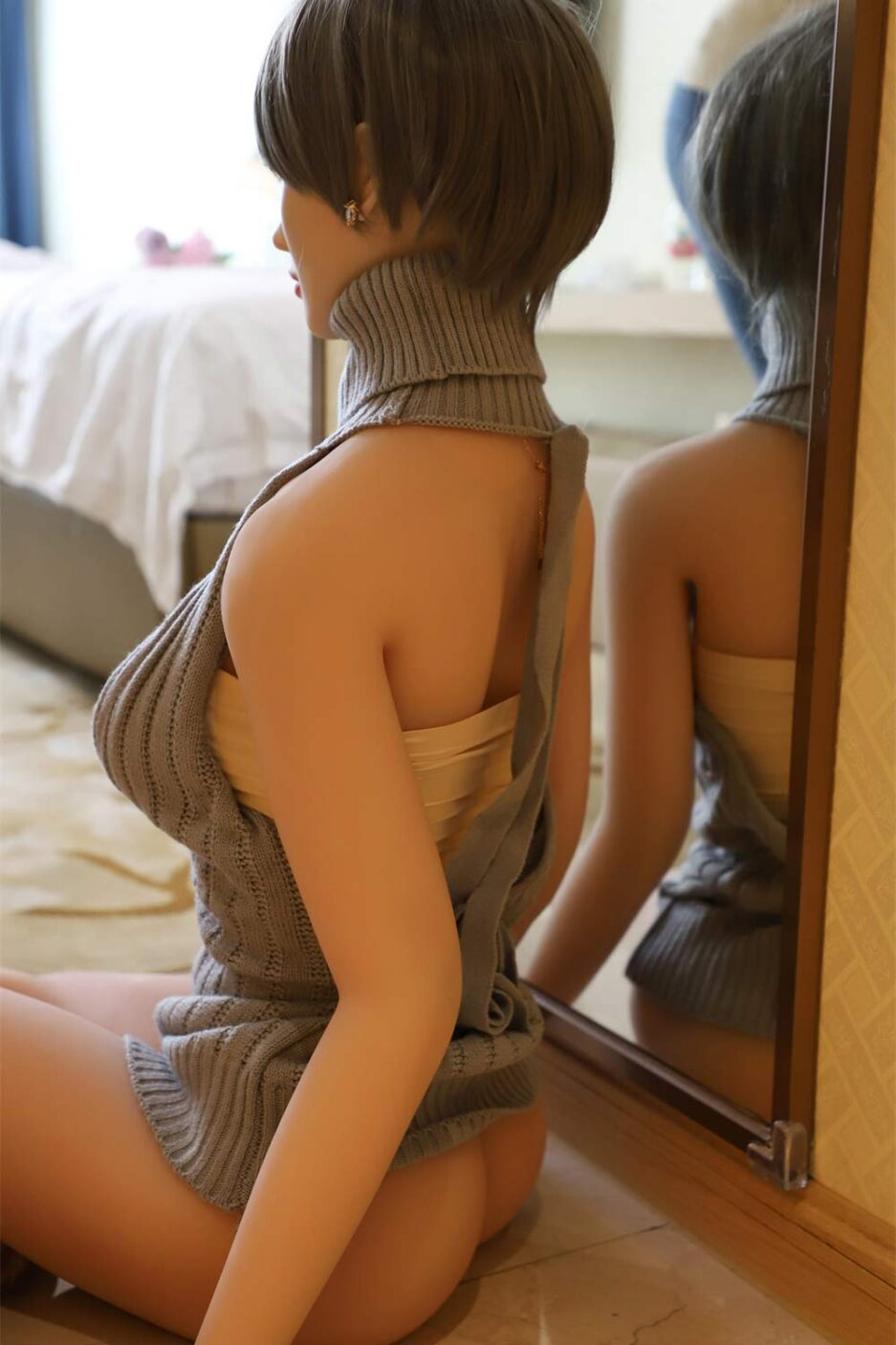 Silicone sex doll in gray clothes