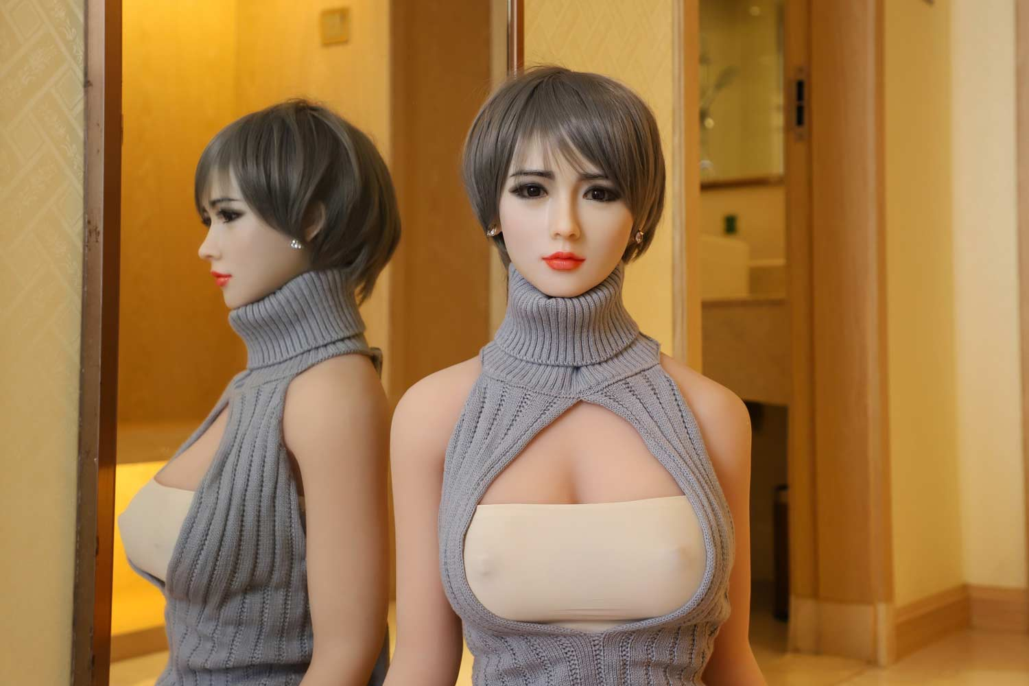 Silicone sex doll in gray sweater