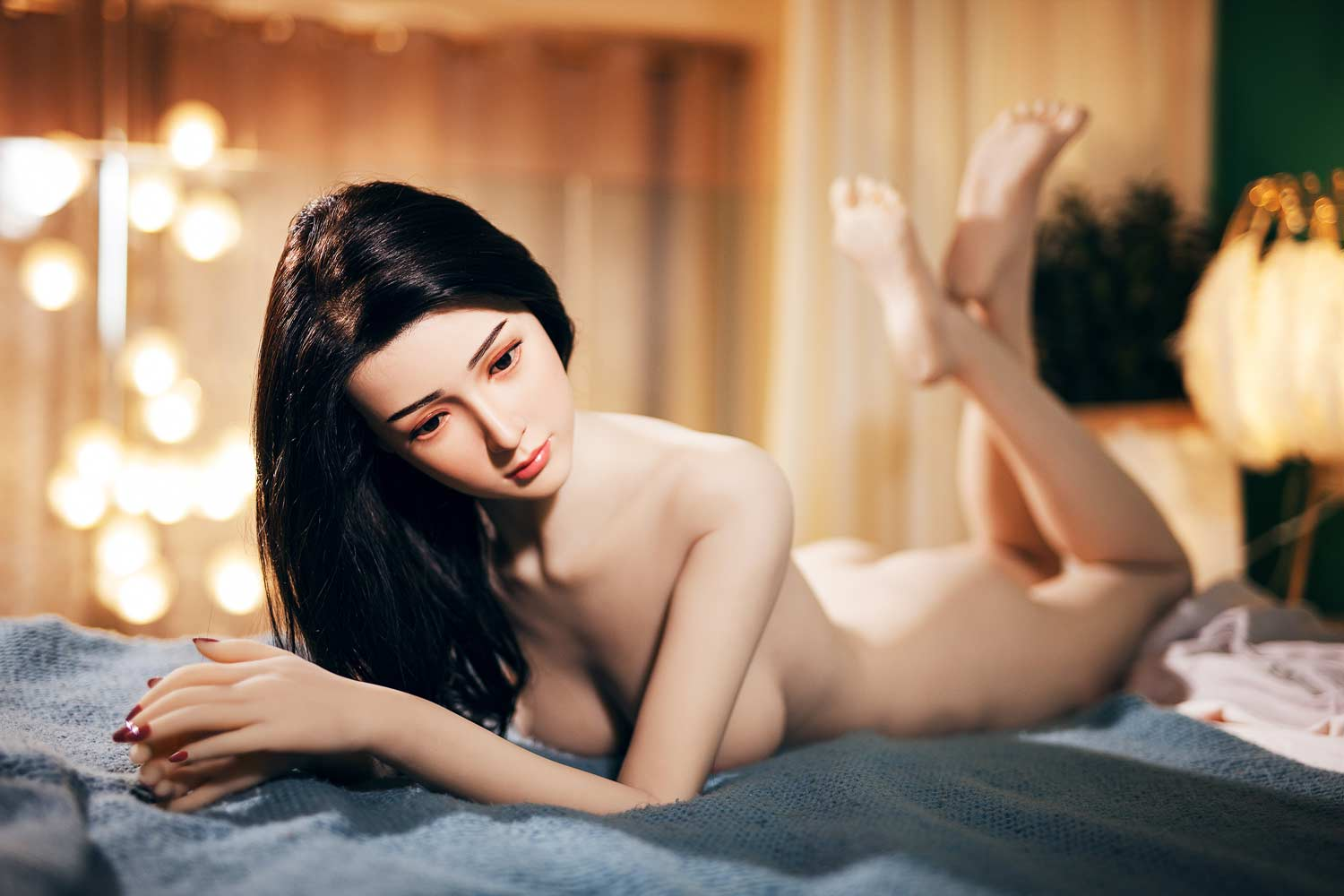 Silicone sex doll lying on the bed