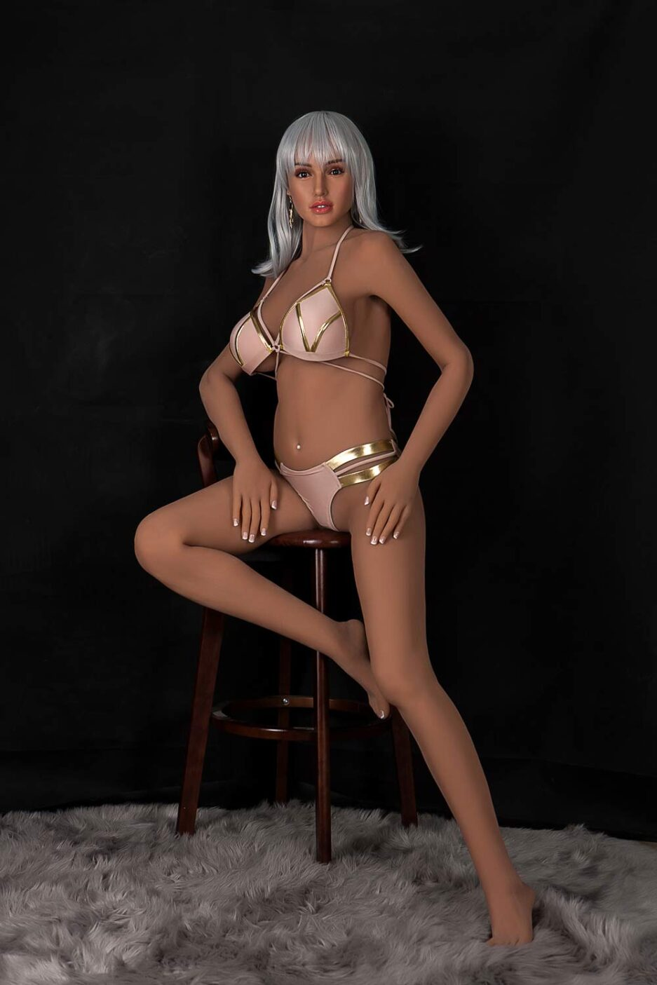 Silicone sex doll sitting in a chair
