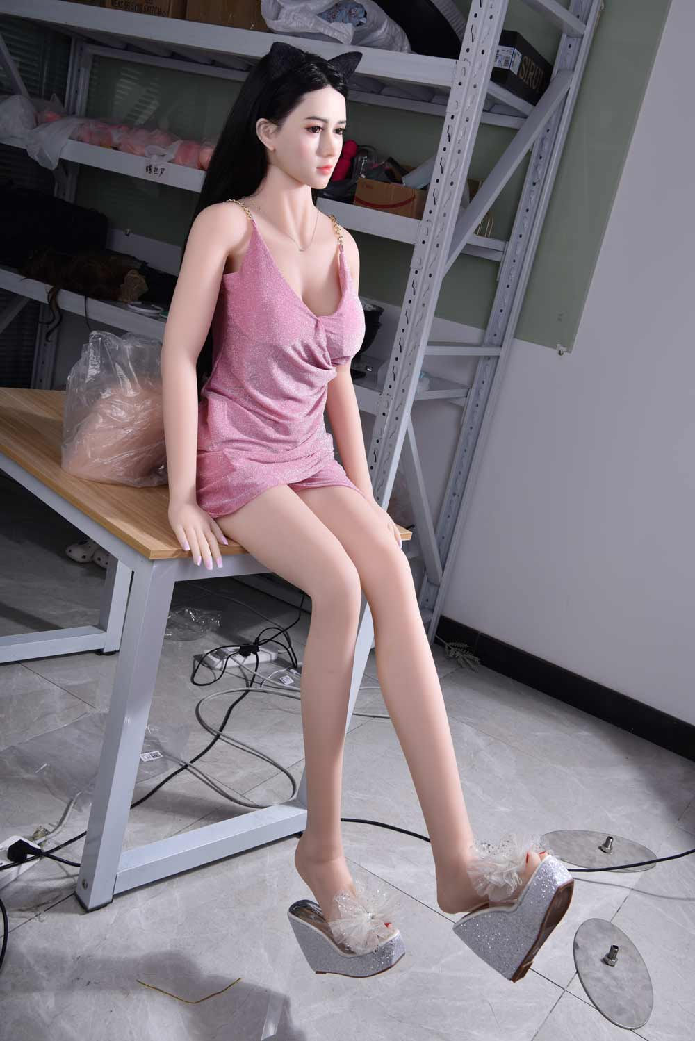 Silicone sex doll sitting on the table