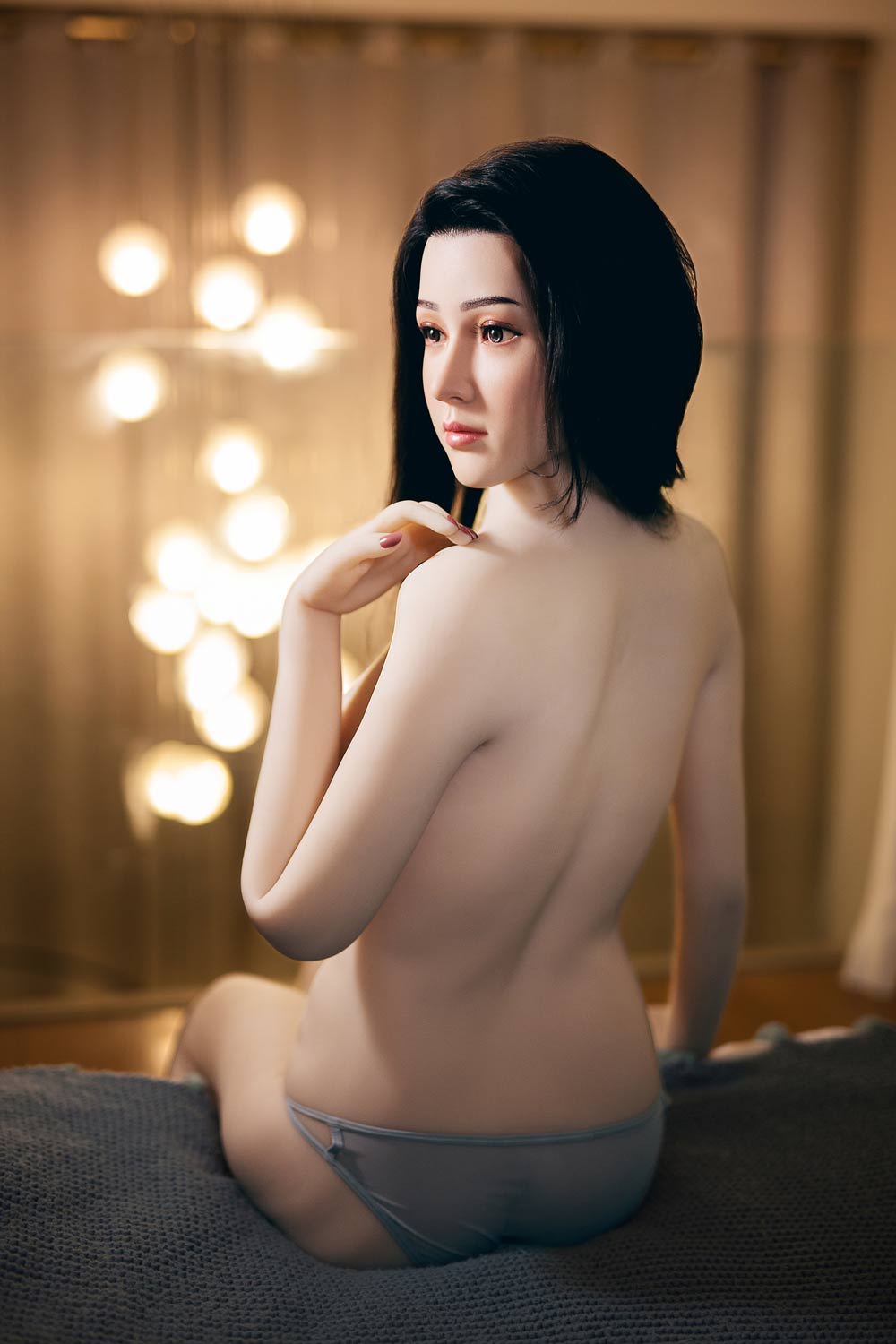 Silicone sex doll with hand touching shoulder