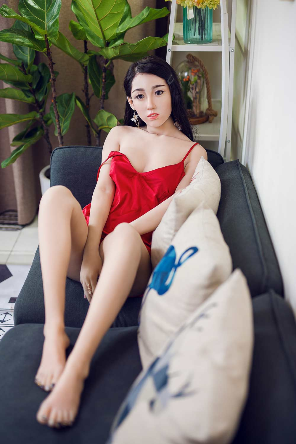 Silicone sex doll with hands between thighs
