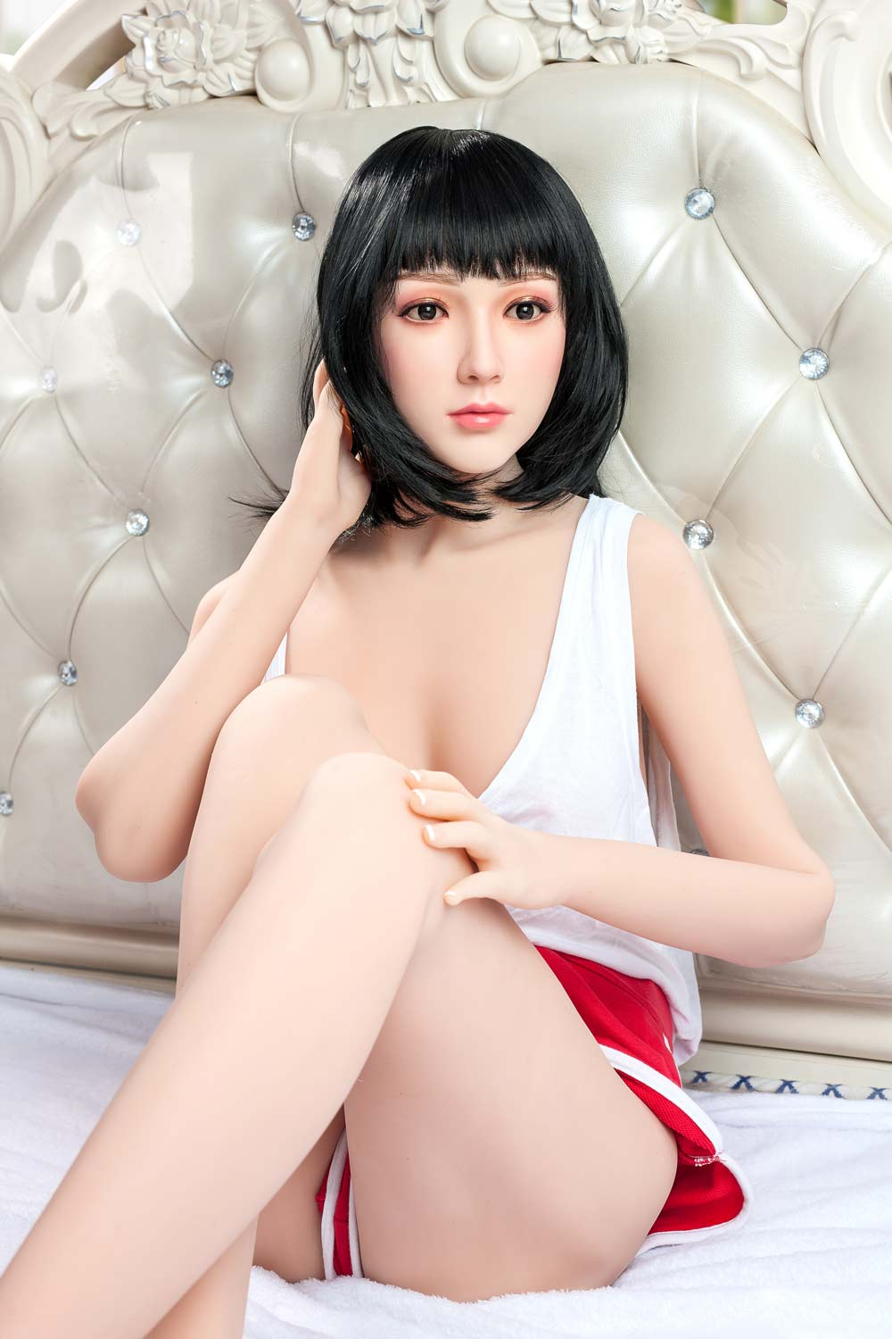 Silicone sex doll with hands on knees