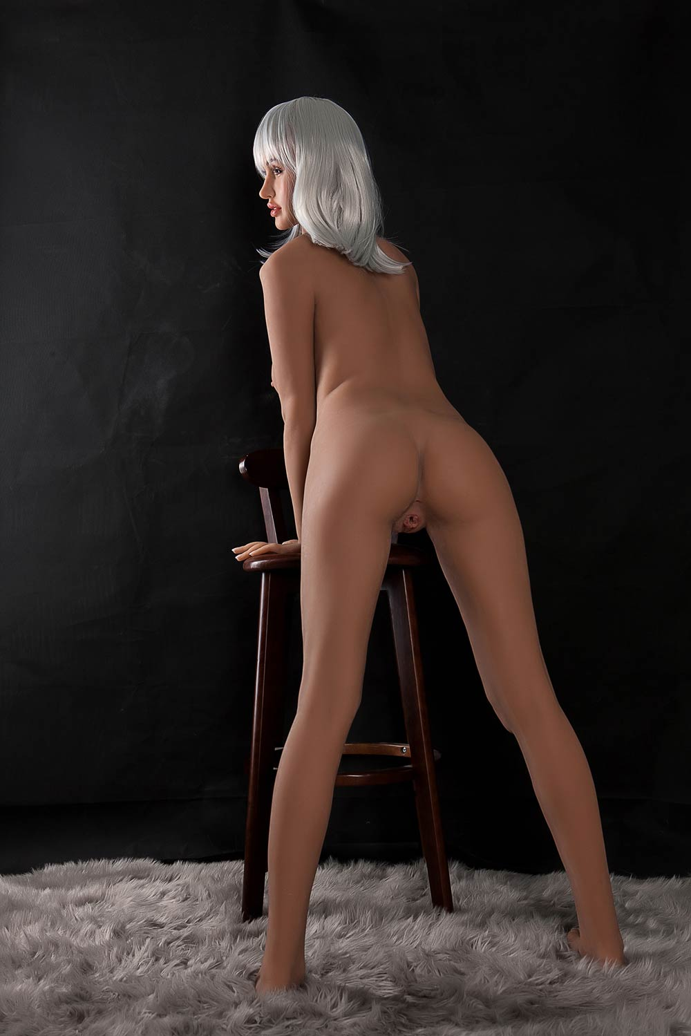 Silicone sex doll with hands on stool