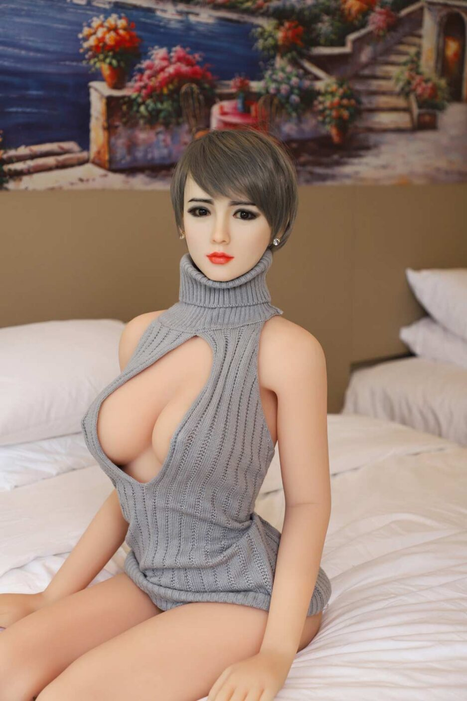 Silicone sex doll with hands on the bed