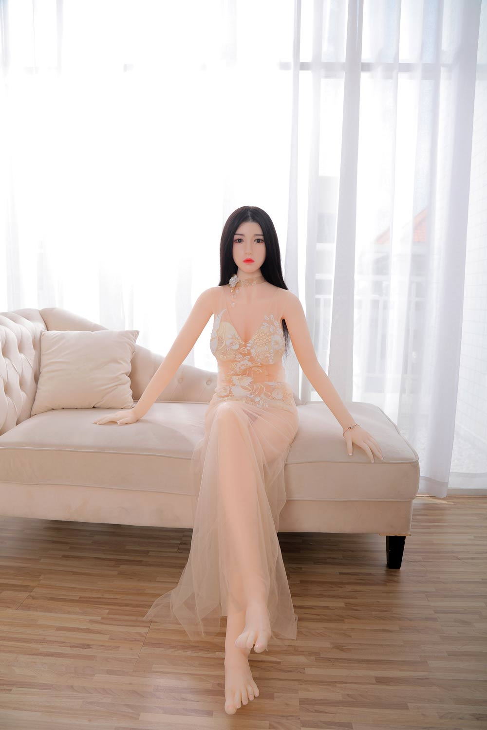 Silicone sex doll with hands on the sofa