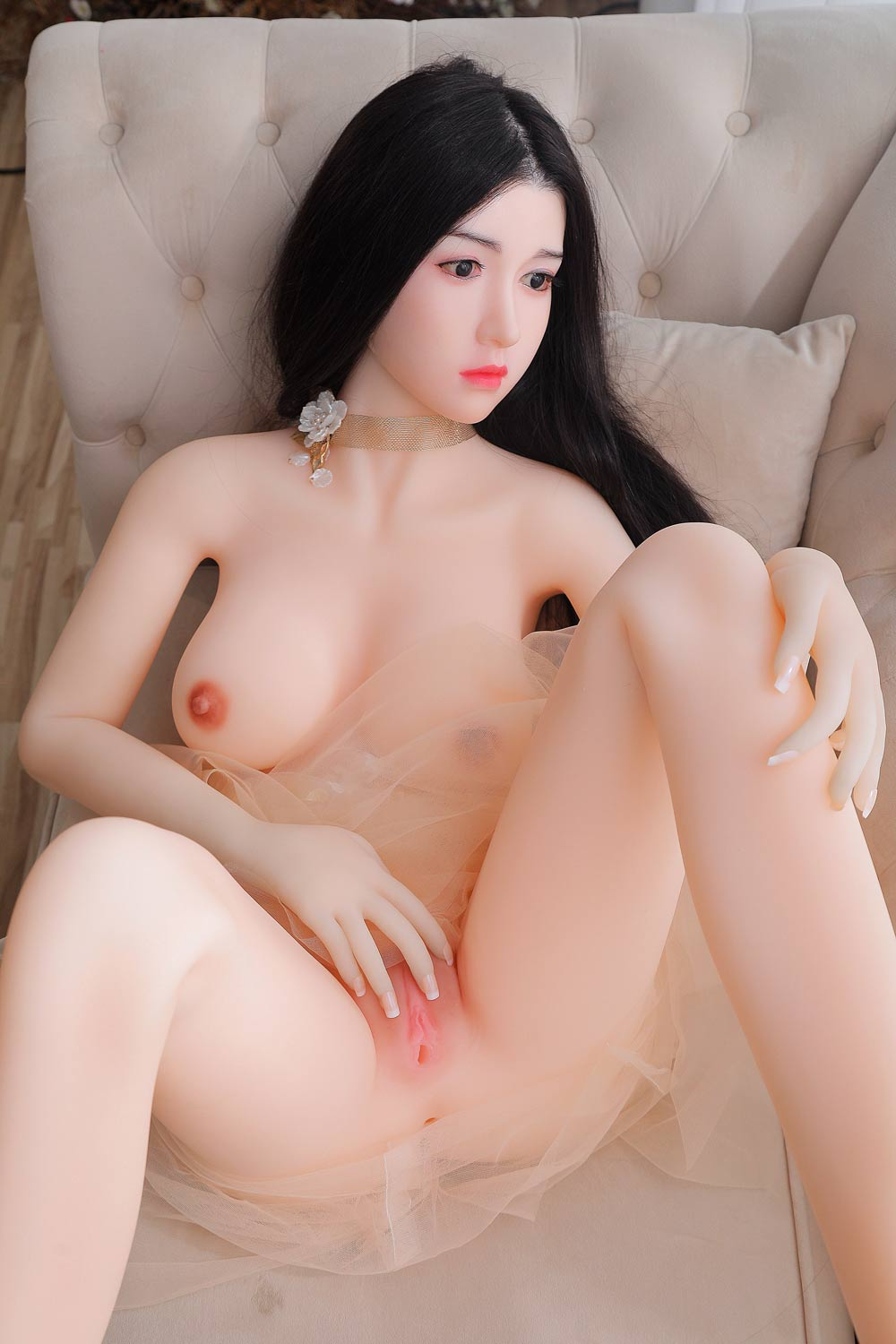 Silicone sex doll with hands touching vagina