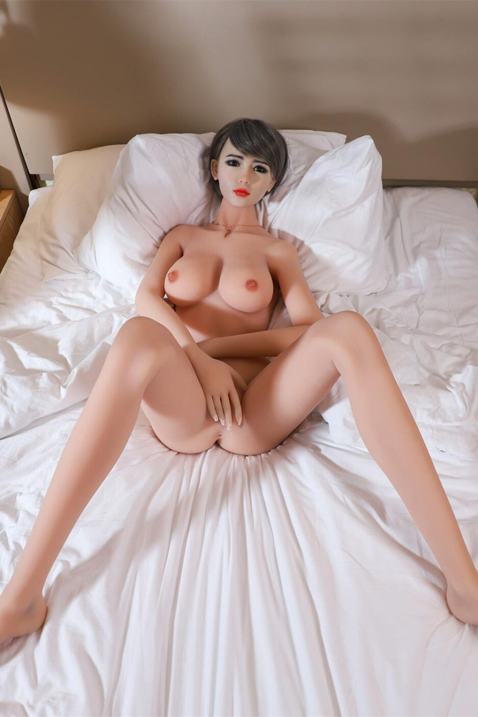 Silicone sex doll with open legs and hands to block vagina