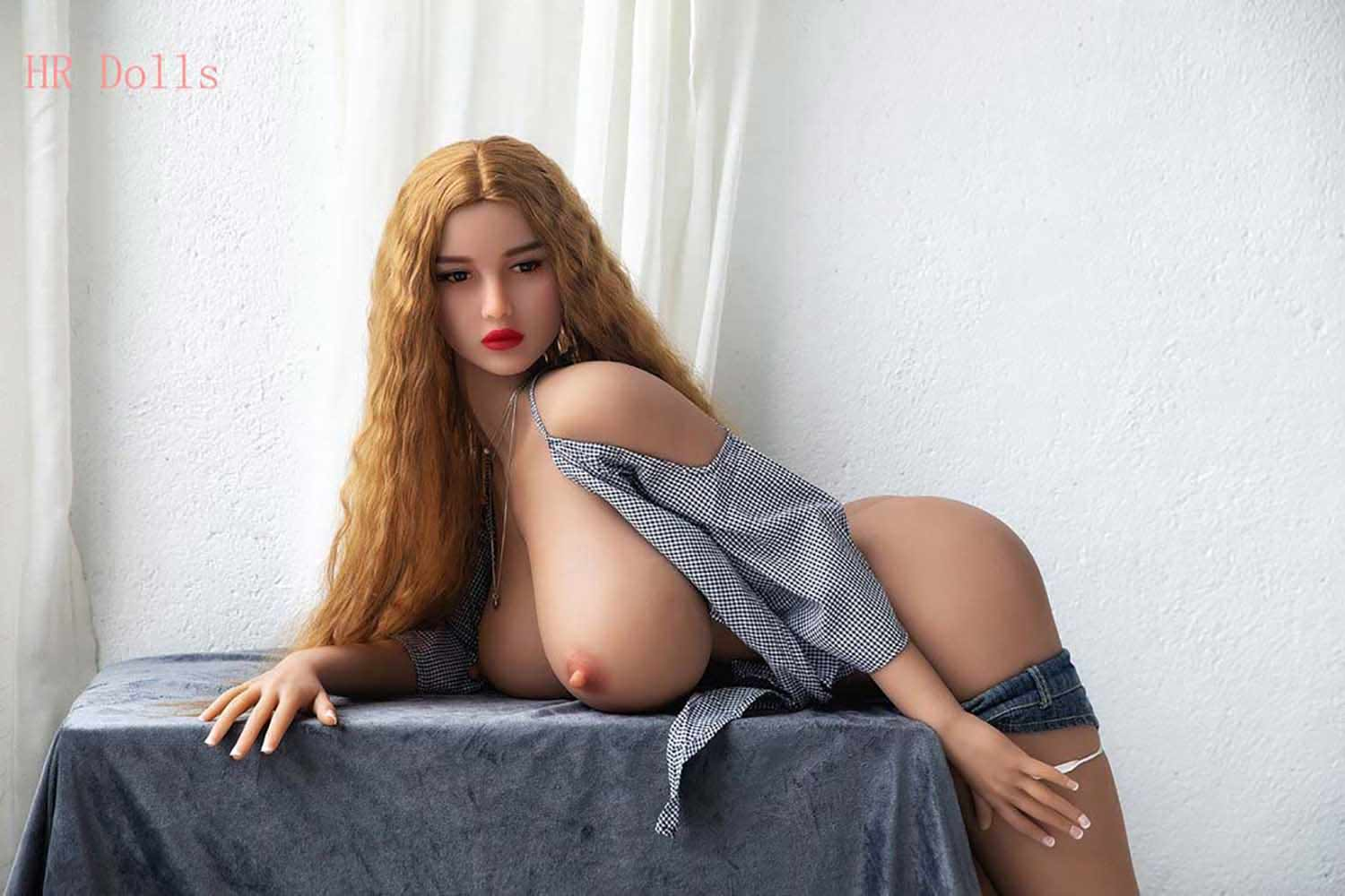 The sex doll with his clothes on the table