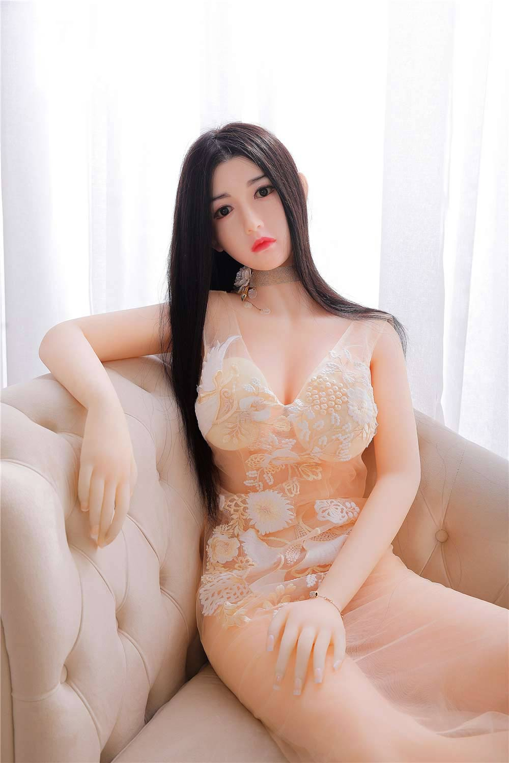 silicoen-sex-doll-sitting-on-a-sofa