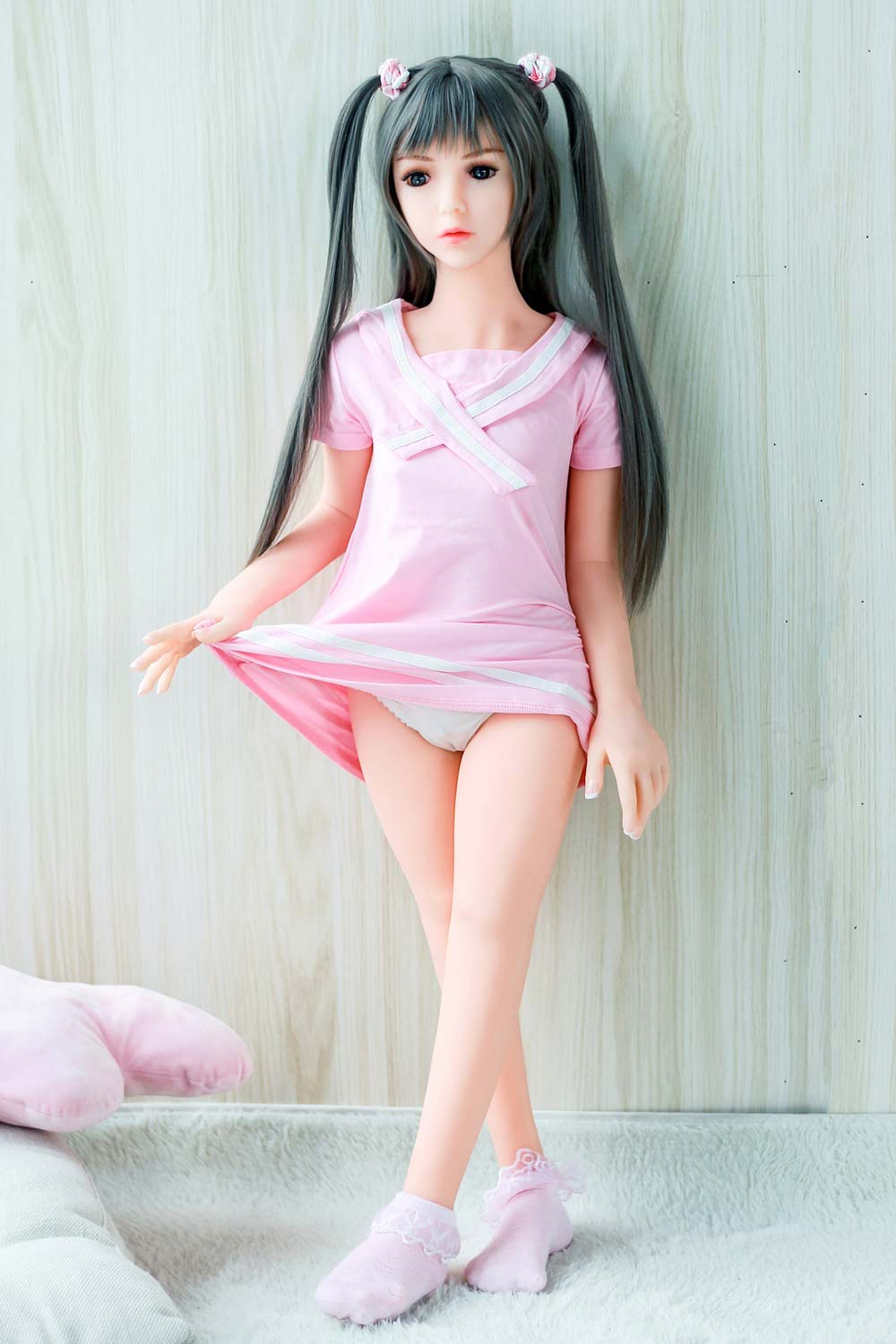 A mini sex doll that lifts a corner of the clothes and reveals panties
