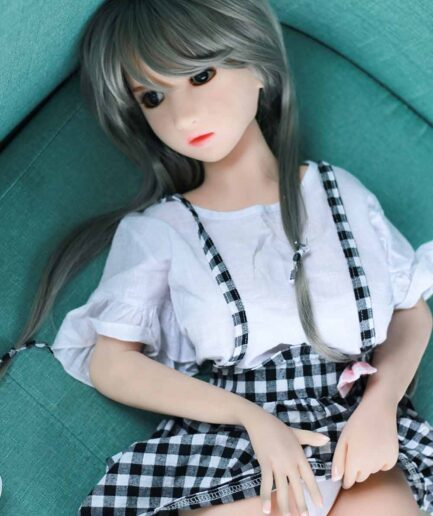 A mini sex doll that lifts her skirt and reveals her panties