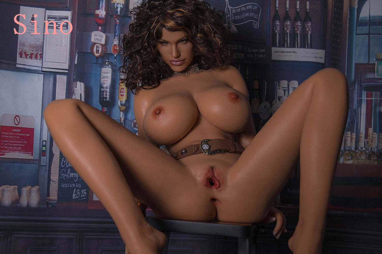 A silicone sex doll with open legs showing thick labia