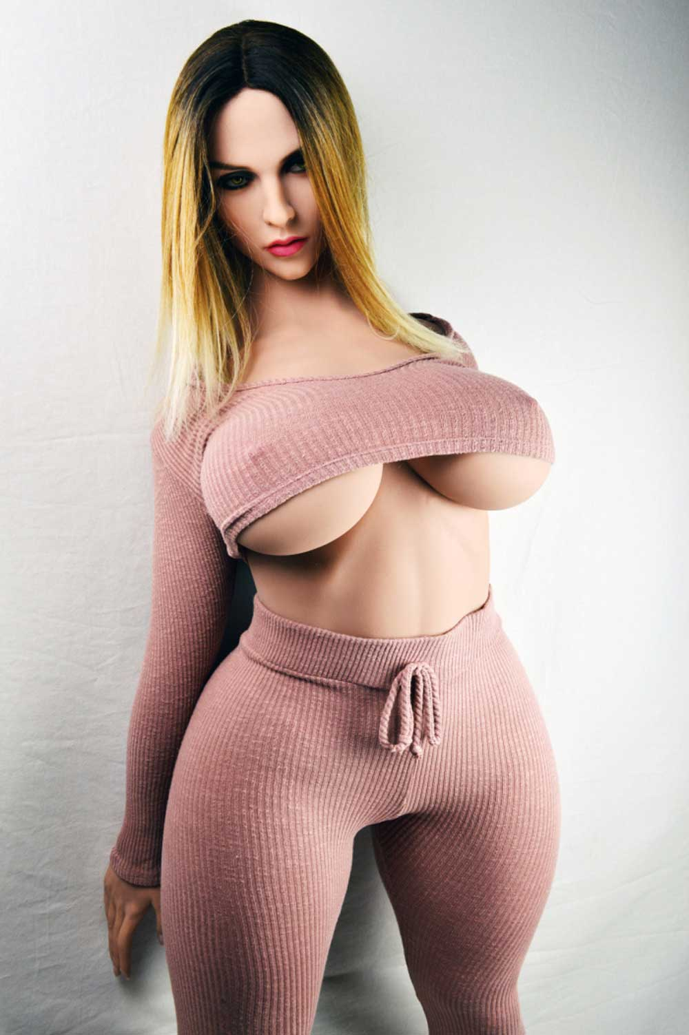 Big breasted big ass sex doll with hands behind back