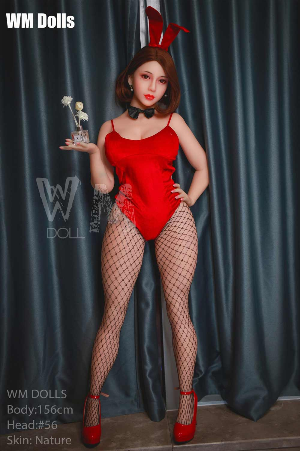 Big breasted sex doll in red high heels