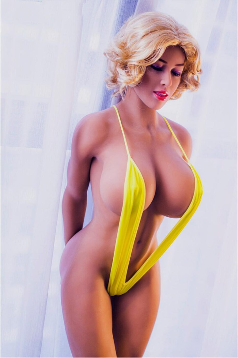 Big breasted sex doll in yellow suspenders