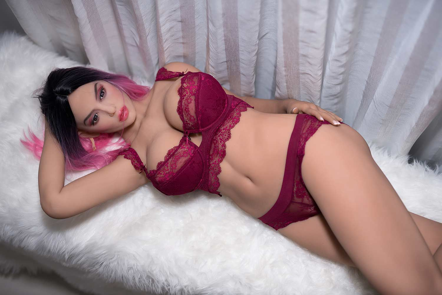 Big breasted sex doll lying on the sofa