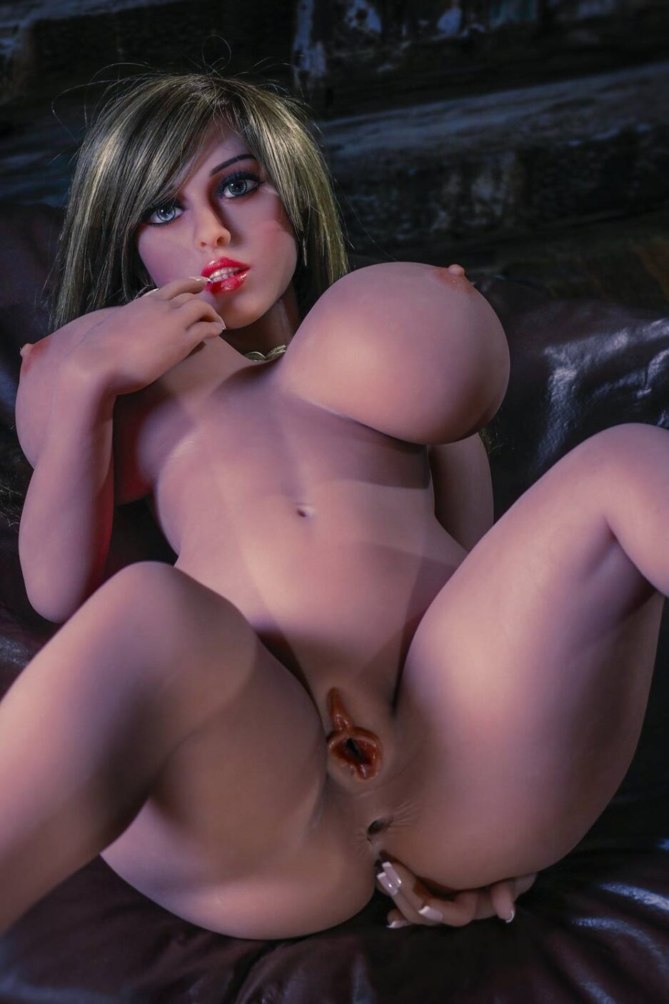 Big breasted sex doll showing vagina