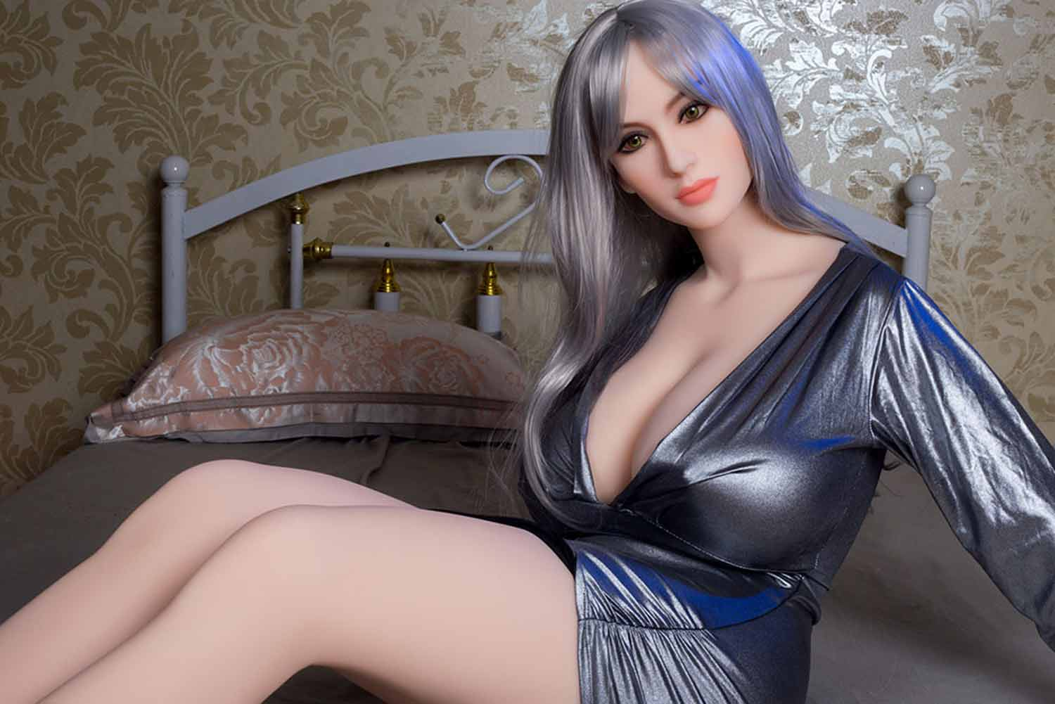 Big breasted sex doll sitting on the bed