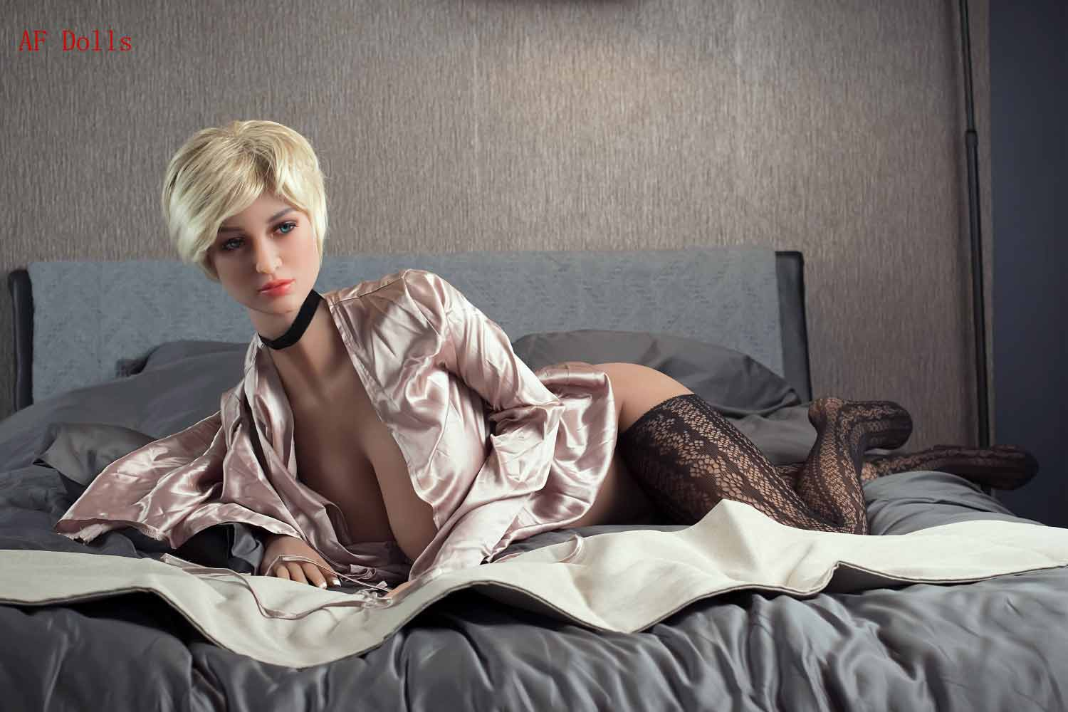 Big breasted sex doll with blond hair