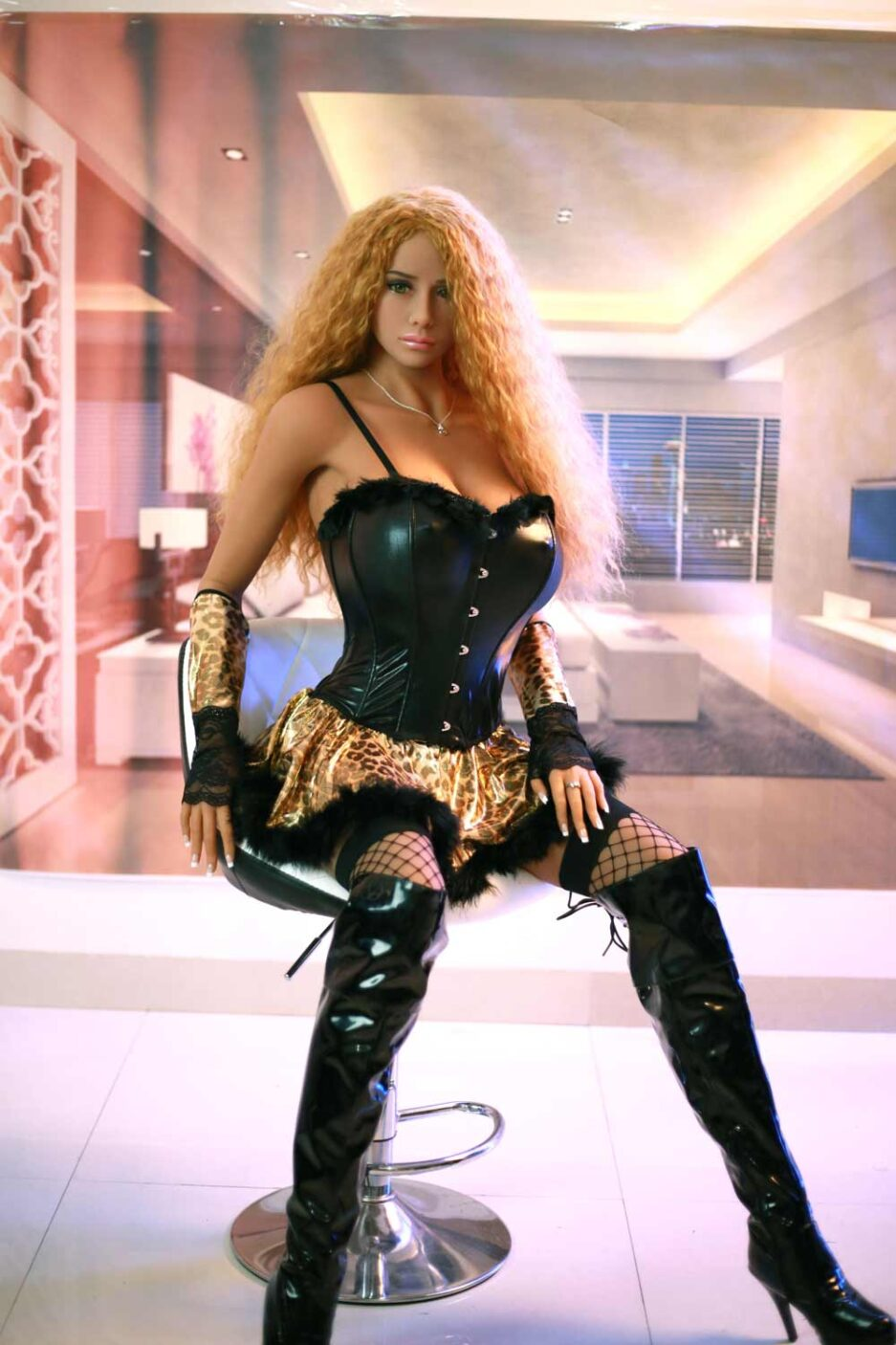 Big breasted sex doll with blonde curly hair