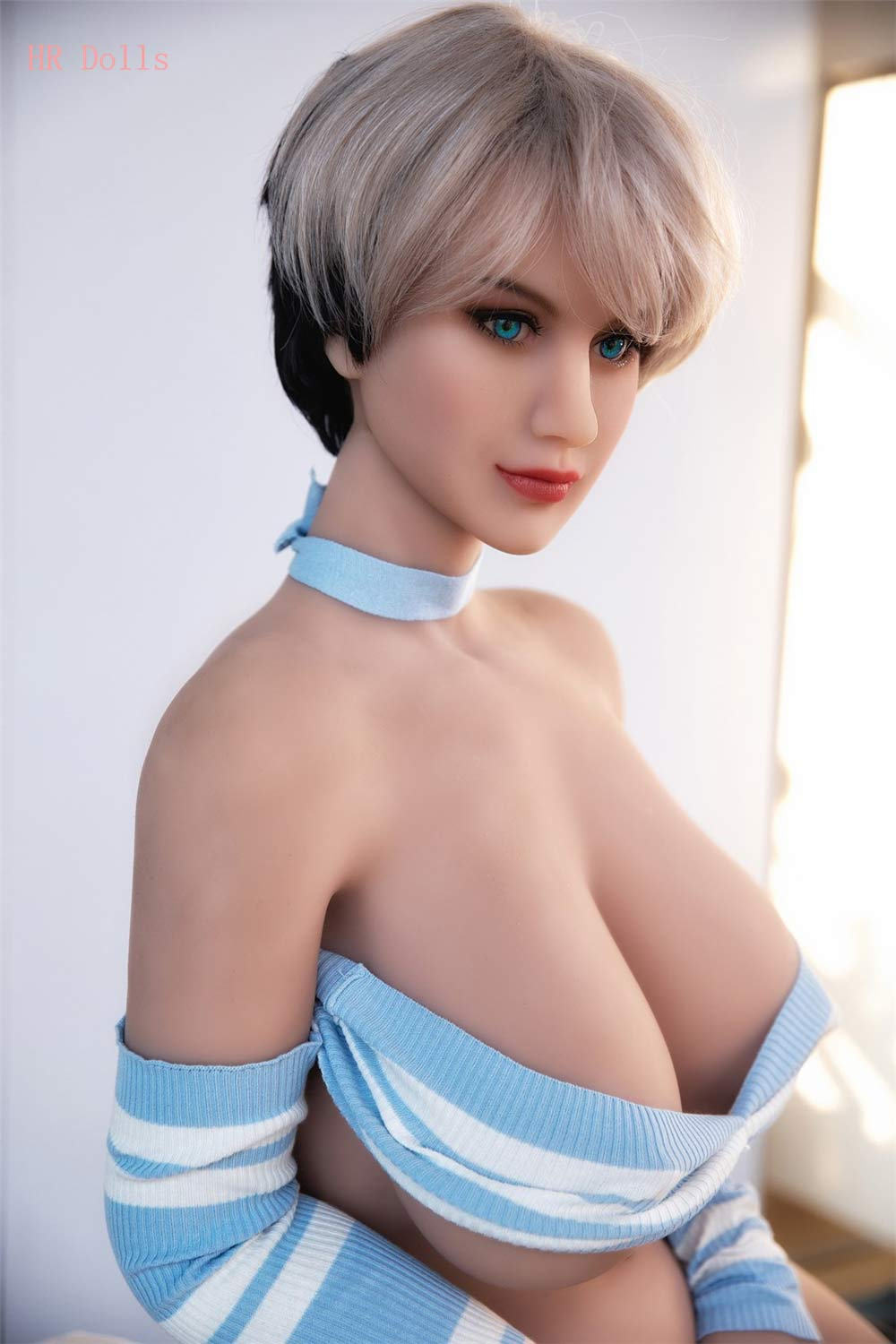 Big breasted sex doll with blue eyes