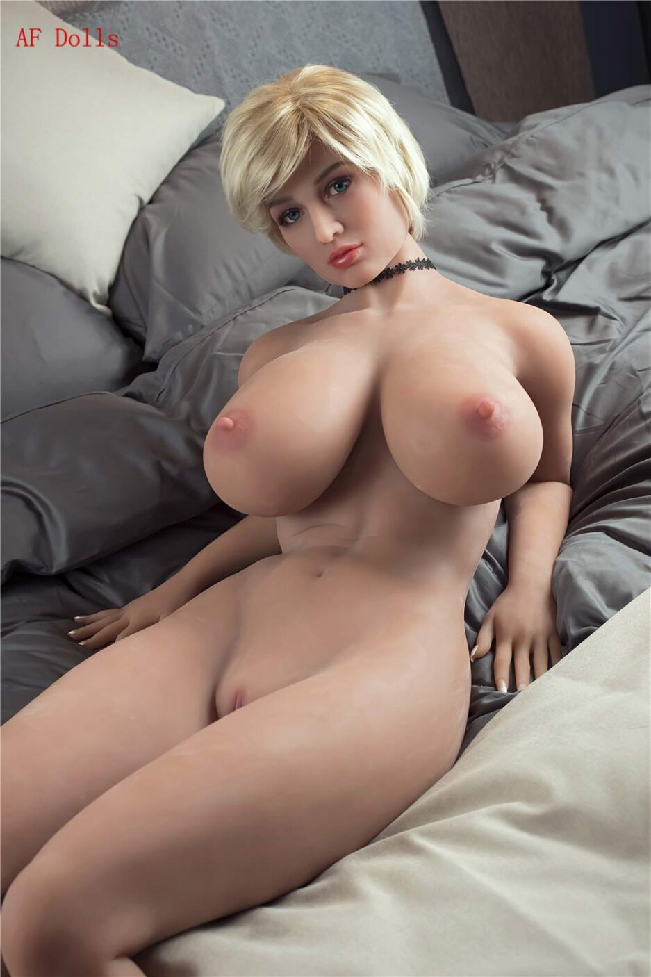 Big breasted sex doll with breasts exposed