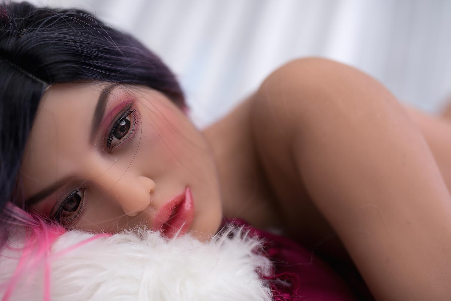 Big breasted sex doll with brown eyes
