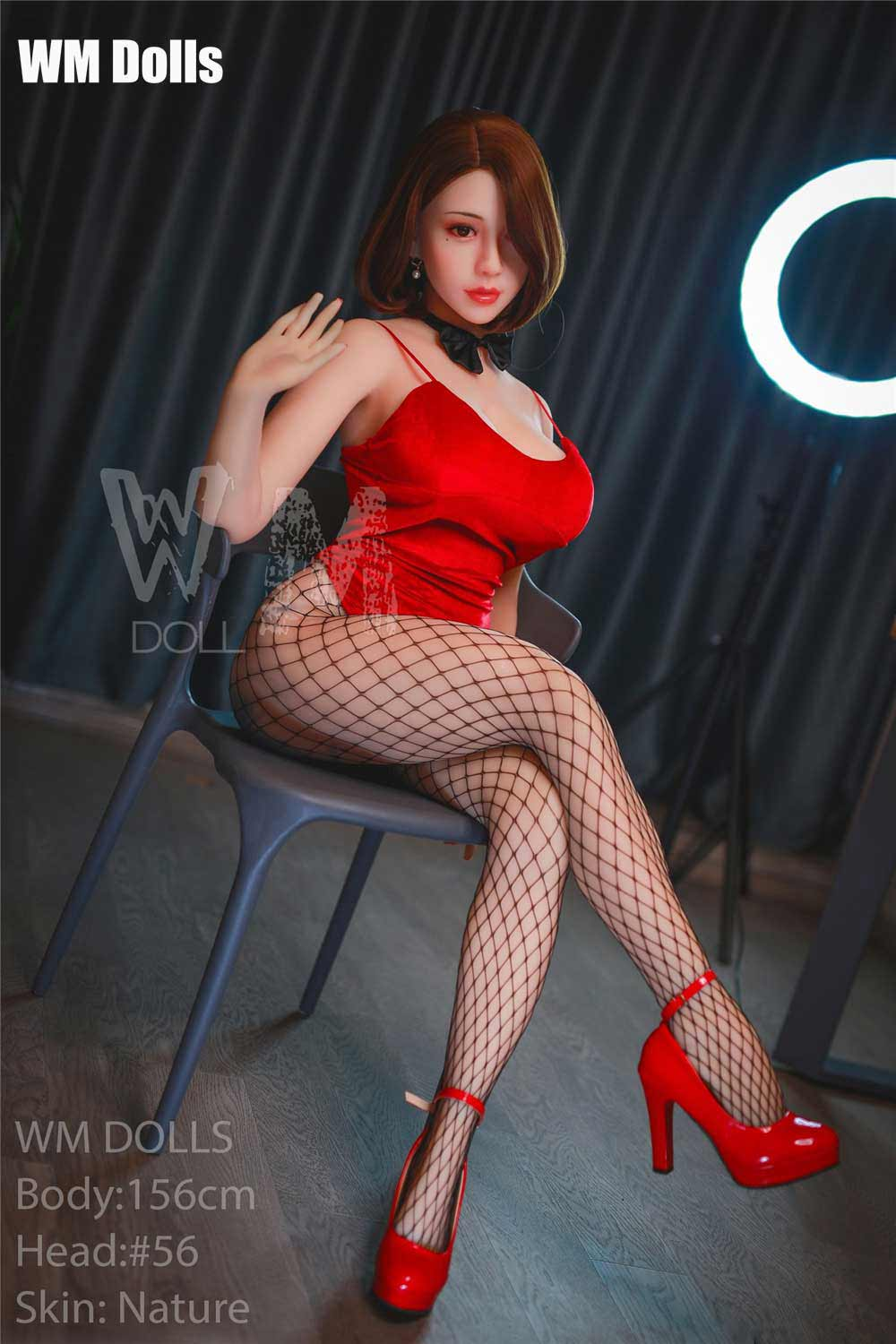 Big breasted sex doll with crossed legs