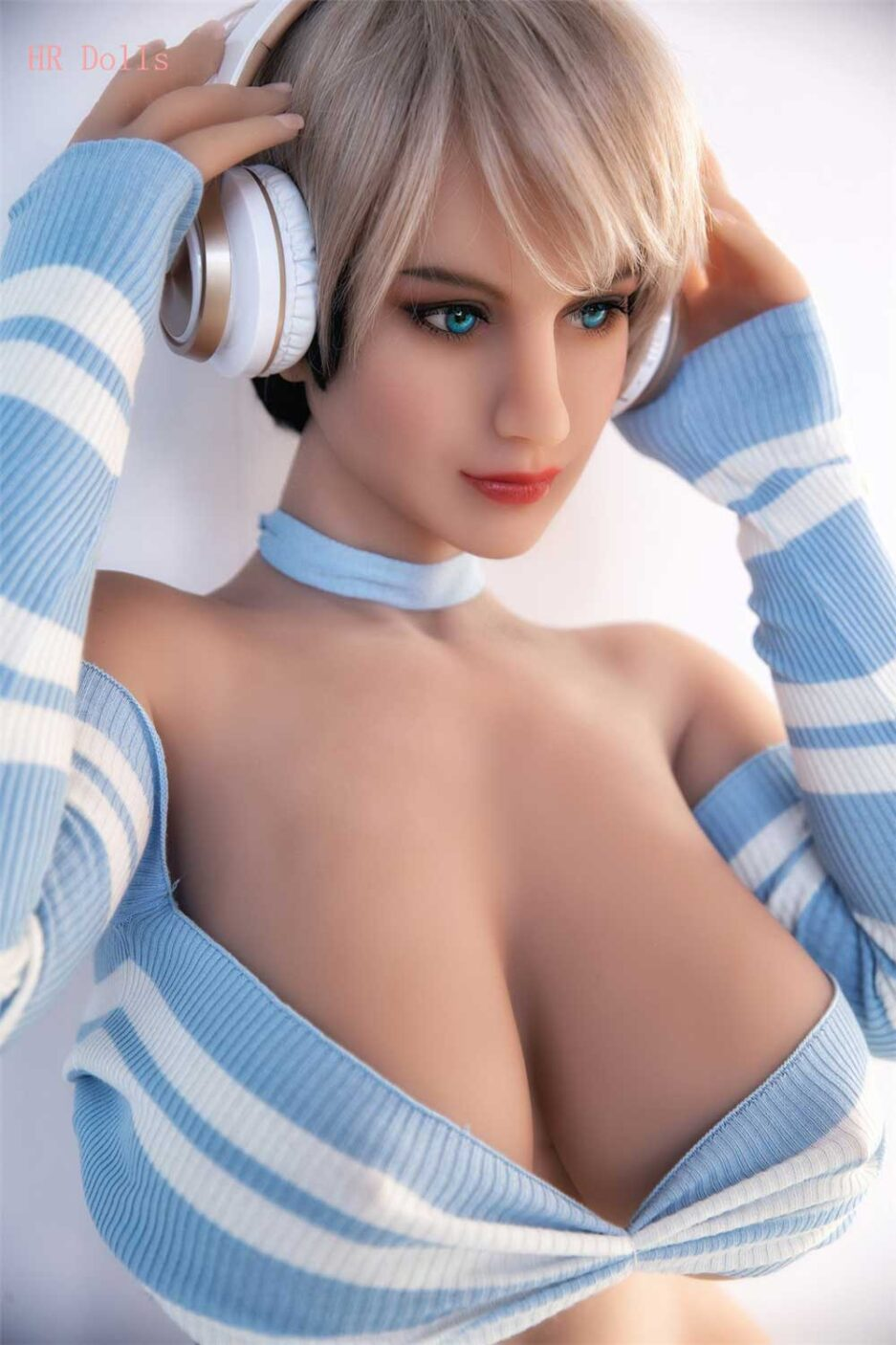 Big breasted sex doll with earphones