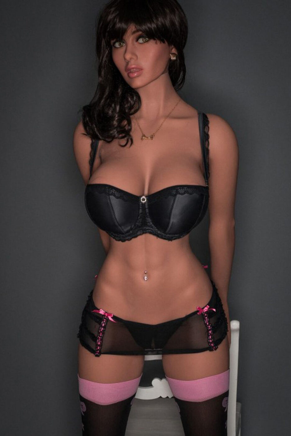 Big breasted sex doll with hands behind
